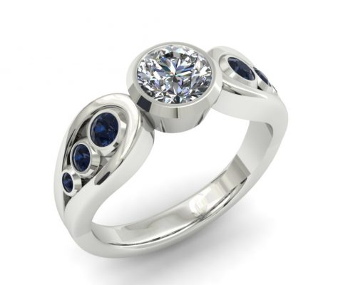 SAPPHIRE AND DIAMOND BEZEL ENGAGEMENT RING